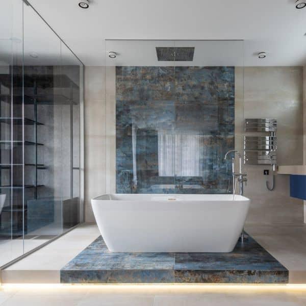 A ceiling shower head on top of a bath tub