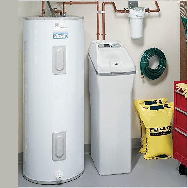 GE Water softener beside a tank