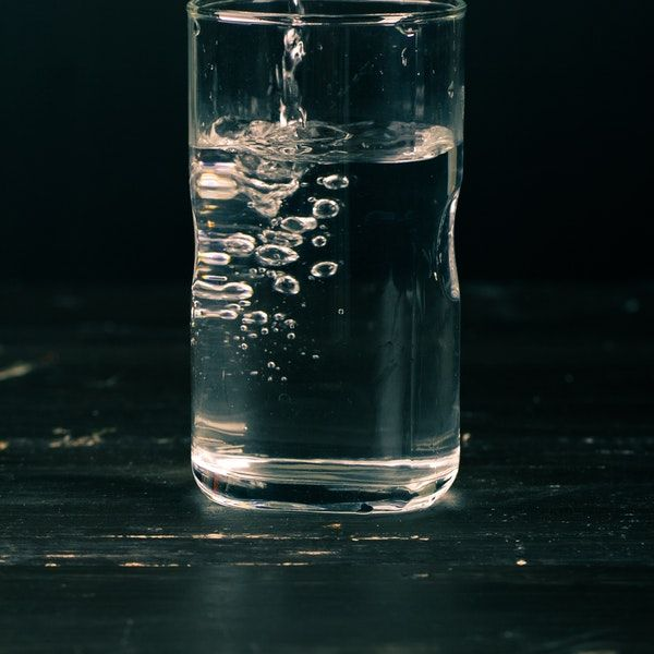 Glass of water from a water softener source