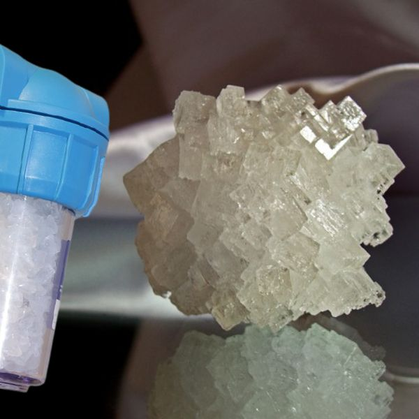 Water softener cartridge and sodium crystals