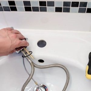 Hand that replaces a faucet